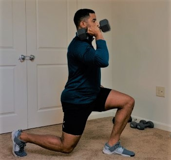 Contralateral reverse lunge to overhead press exercise demonstrated by Staunton and Harrisonburg personal trainer Donte Collins, part 1.