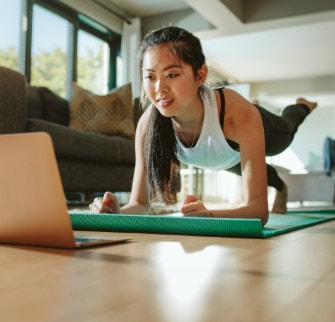 Woman doing an online workout at home.