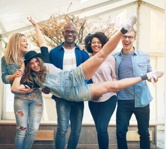 A group of happy, outgoing people that one might assume are extroverts.