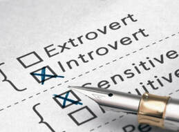 A pen and a personality questionnaire illustrating Introverts and Extroverts--two basic personality classifications.